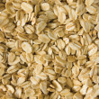 Oatmeal background, rolled raw oats macro closeup vertical — Stock Photo #6732162