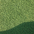 Artificial grass fake turf synthetic lawn field macro closeup — Stock Photo