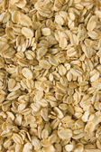 Oatmeal background, rolled raw oats macro closeup vertical — Stock Photo