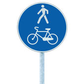 Bicycle and pedestrian lane road sign on pole post, blue — Stock Photo
