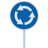 Roundabout crossroad road traffic sign isolated, blue, white arrows — Stock Photo