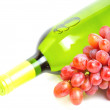 Bottle of white wine and bunch of pink grape isolated - Stock Photo