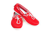 Pair of red moccasins isolated over white — Stock Photo