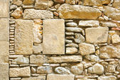 Fragment of ancient wall made of stones — Stock Photo
