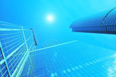 Modern business centre skyscrapers blue-toned — Stock Photo