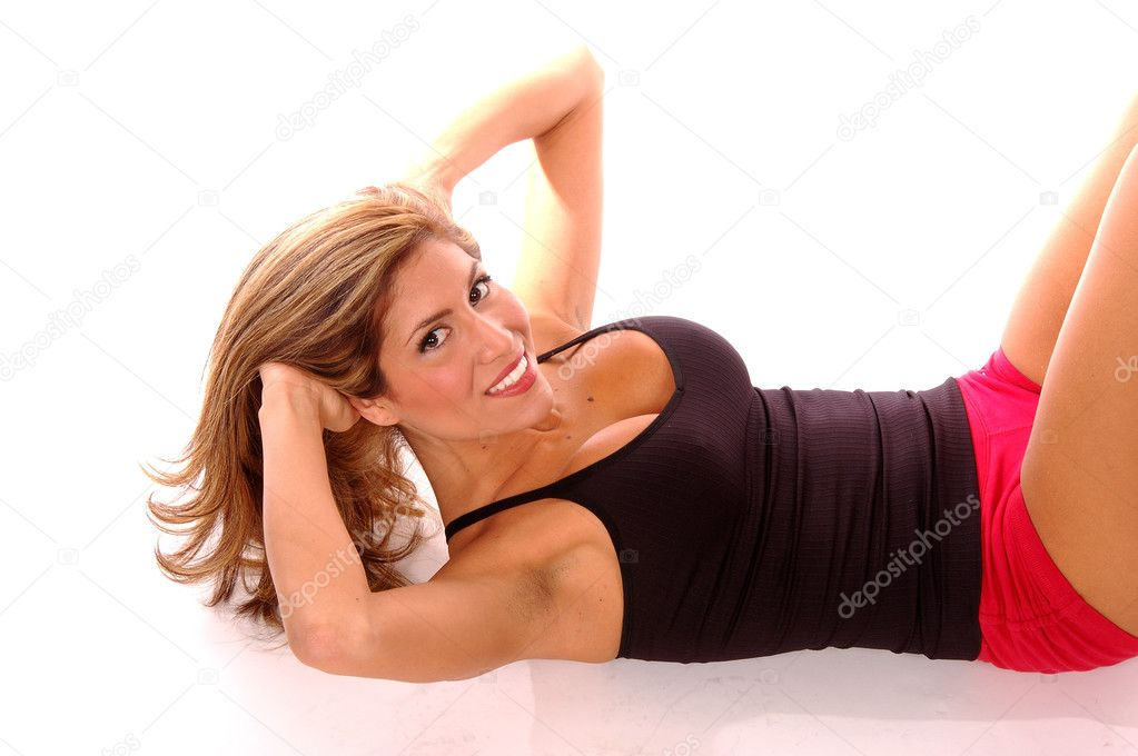 Sexy Latino fitness instructor working out doing situps — Stock Photo #6716769