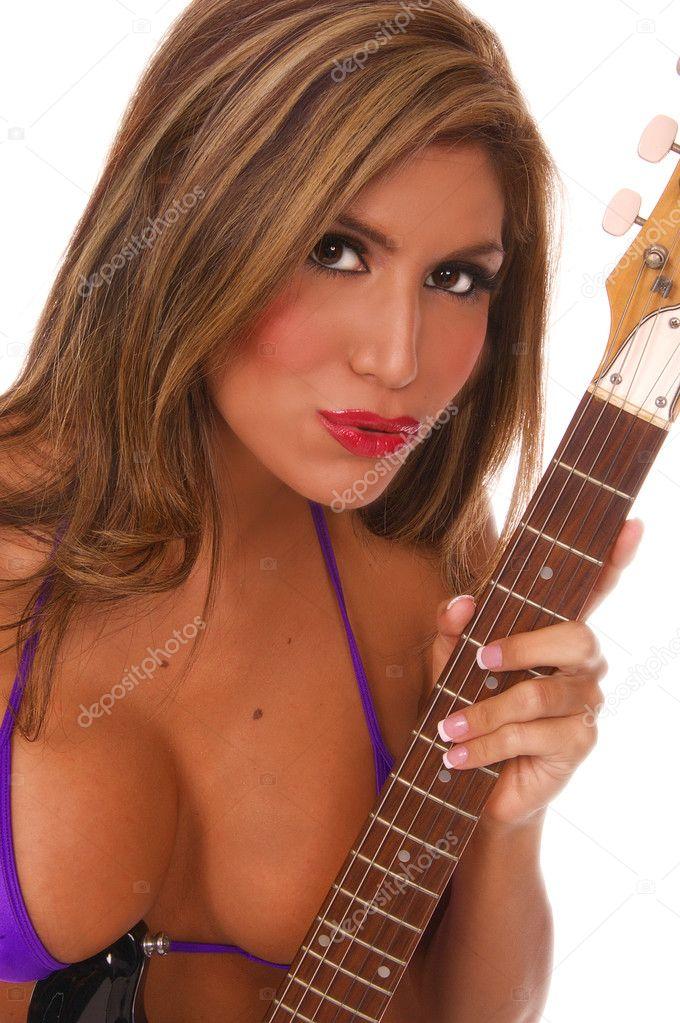 depositphotos 6717758 Rock and Roll Bikini Natalia Spice Outside Beach Pink White Bikini Skimpy Nude Sexy Latina