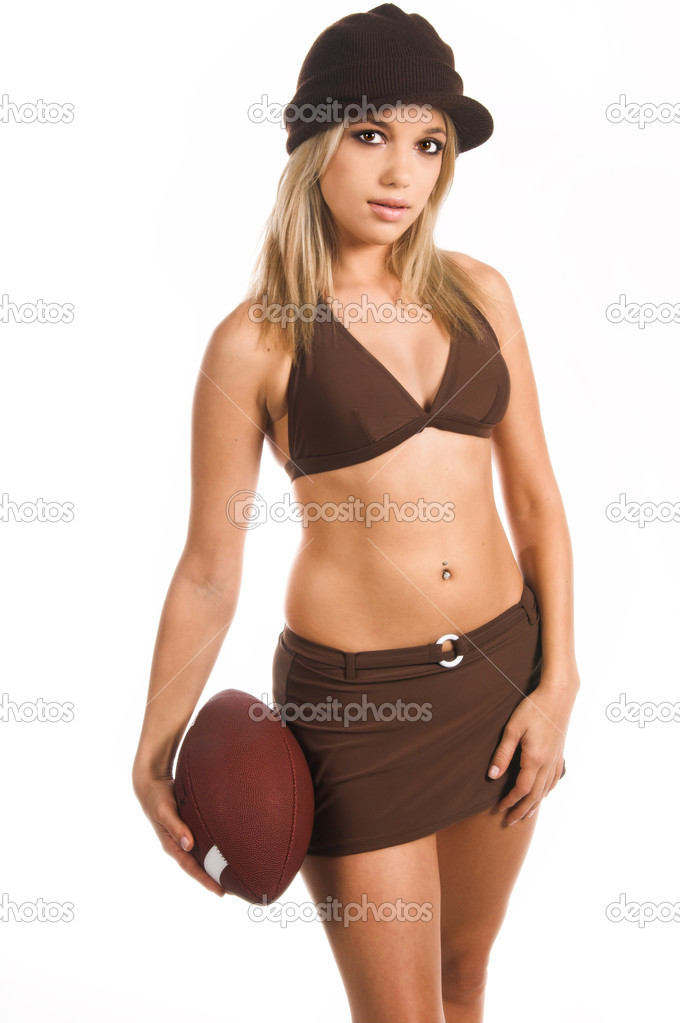 Sexy woman in a bikini top, skirt and knit cap, holding a footballBikini by Swim Bay — Stock Photo #6738421