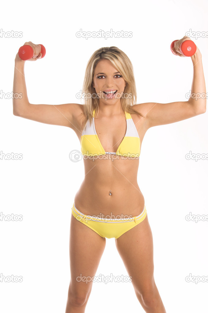 Fit and trim young woman working out with dumbellsBikini By Swimbay — Stock Photo #6738556