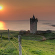 Doonegore castle at sunset in Ireland - Stock Photo