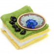 Royalty-Free Stock Photo: Soft towels with black spa stones and bath salt