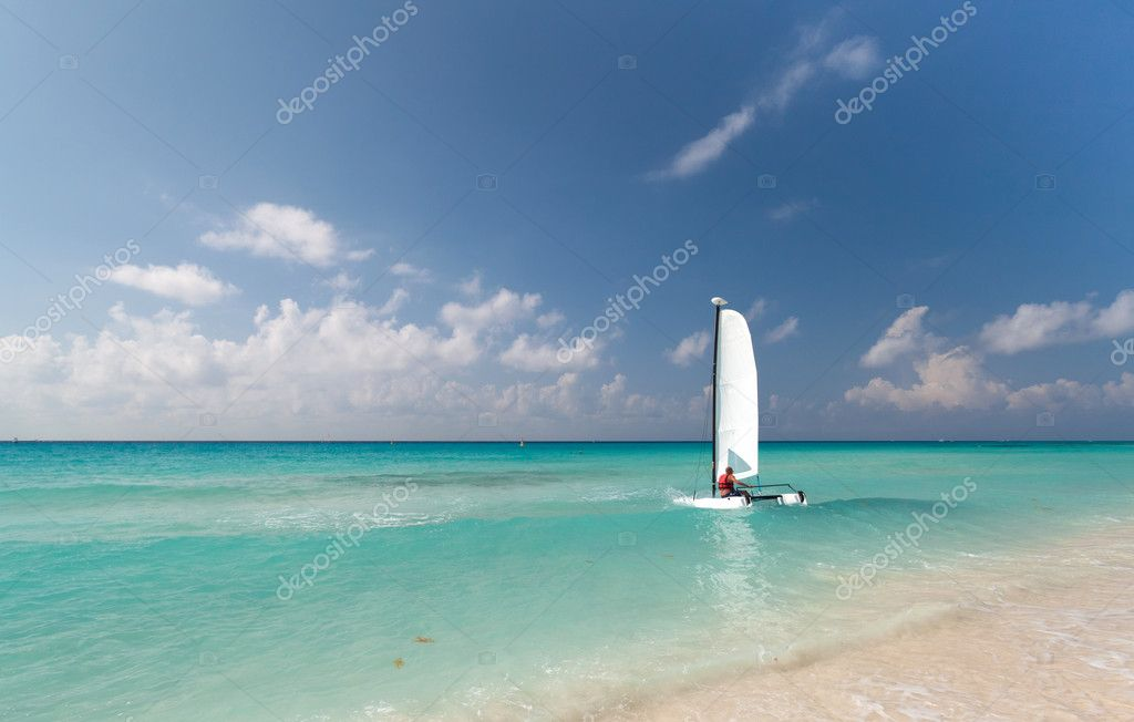Catamaran on the coast of Caribbean Sea in Mexico  Stock Photo #6637226