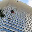 Cliffhanger Window Washers - Stock Photo