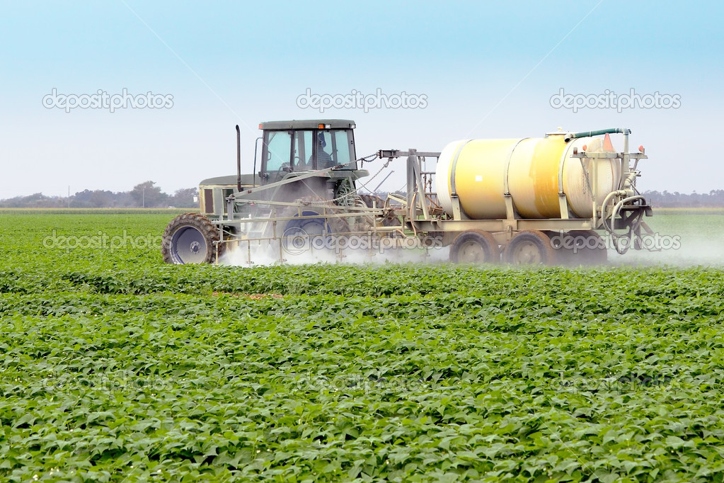 The application of pesticides on a commercial agricultural field  — Stock Photo #6497987