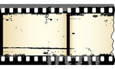 Old grungy film strip — Vettoriale Stock