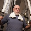 Stock Photo: Senior Adult Man Working Out in the Gym.