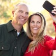 Attractive Couple Pose for a Self Portrait Outdoors - Lizenzfreies Foto