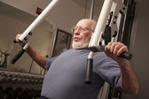 Senior Adult Man Working Out in the Gym. — Stock Photo
