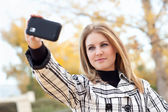 Pretty Young Woman Taking Picture with Camera Phone — Stock Photo