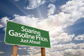 Soaring Gasoline Prices Green Road Sign and Clouds — Stock Photo