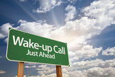 Wake-up Call Green Road Sign and Clouds — Stock Photo