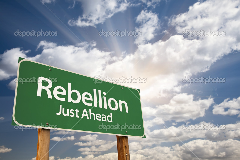 Rebellion Green Road Sign with Dramatic Clouds, Sun Rays and Sky. — Stock Photo #5449947