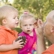 Cute Twin Children Talk with Dad in Park — Stock Photo