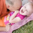 Loving Dad Tickles Daughter in Park — Stock Photo