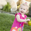 Smiling Young Girl in The Park Holding Apple — Stock Photo