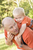 Father and Son Piggyback in the Park — Stock Photo