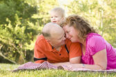 Affectionate Couple with Son in Park — Stock Photo