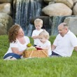 Happy Young Family Enjoy Picnic in Park — Stockfoto