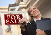 Real Estate Agent with Keys in Front of Sign and House — Stock Photo
