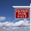 Stock Photo: Red Home For Sale Real Estate Sign Over Clouds and Sky