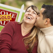 Royalty-Free Stock Photo: Mixed Race Couple in Front of Sold Real Estate Sign