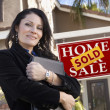 Hispanic Woman in Front of Real Estate Sign and New Home — Stock Photo