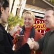 Hispanic Female Real Estate Agent Handing Keys to Excited Couple — Stock Photo