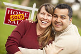 Mixed Race Couple in Front of Sold Real Estate Sign — Stock Photo