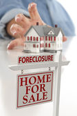 Foreclosure Sign in Front of Woman Reaching for House — Stock Photo