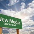 New Media Green Road Sign Against Clouds — Stock Photo