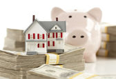 Small House and Piggy Bank with Stacks Money — Stock Photo