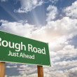 Rough Road Green Road Sign - Stock Photo