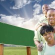 African American Family in Front of Blank Green Road Sign — Stock Photo