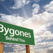 Bygones, Behind You Green Road Sign - Stock Photo
