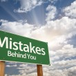 Mistakes, Behind You Green Road Sign - Stock Photo