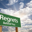 Regrets, Behind You Green Road Sign - Stock Photo