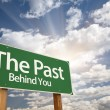 The Past, Behind You Green Road Sign - Stock Photo