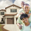 Stock Photo: Attractive AfricAmericFamily in Front of Home