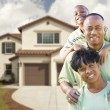 Attractive African American Family in Front of Home - Stock Photo