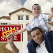 Hispanic Father and Son in Front of House, Sold Sign — Stok fotoğraf